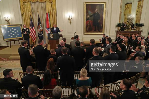 S President Donald Trump asks soldiers and Afghan interpreters who were with US Army Master Sgt Matthew Williams during battle to stand during...