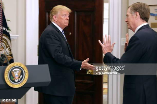 S President Donald Trump attempts to shake hands with US Trade Representative Robert Lighthizer after signing the 'Section 232 Proclamation' on steel...