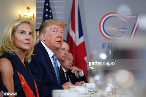 S President Donald Trump attends a bilateral meeting with Britain's Prime Minister Boris Johnson during the G7 summit on August 25 2019 in Biarritz...