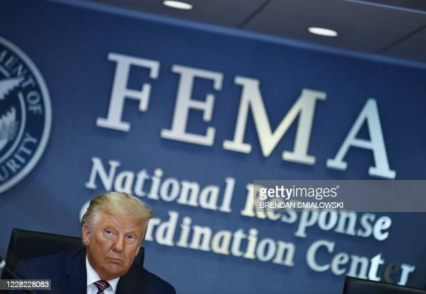 President Donald Trump attends a briefing for Hurricane Laura on August 27, 2020 at the Federal Emergency Management Agency Headquarters in...