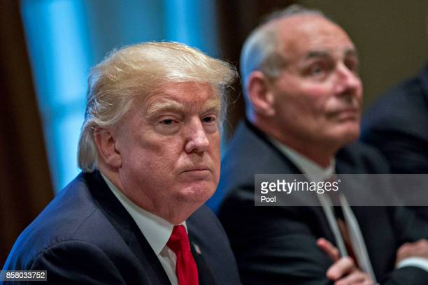 S President Donald Trump attends a briefing with senior military leaders in the Cabinet Room of the White House October 5 2017 in Washington DC...