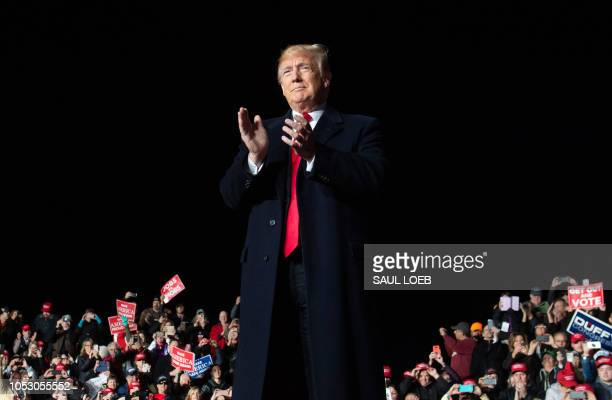 US President Donald Trump attends a campaign rally at Central Wisconsin Airport in Mosinee Wisconsin on October 24 2018 / ALTERNATIVE CROP