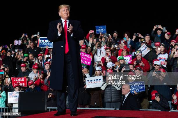 US President Donald Trump attends a campaign rally at Central Wisconsin Airport in Mosinee Wisconsin on October 24 2018