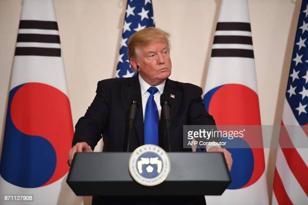 US President Donald Trump attends a joint press conference with South Korea's President Moon JaeIn at the presidential Blue House in Seoul on...