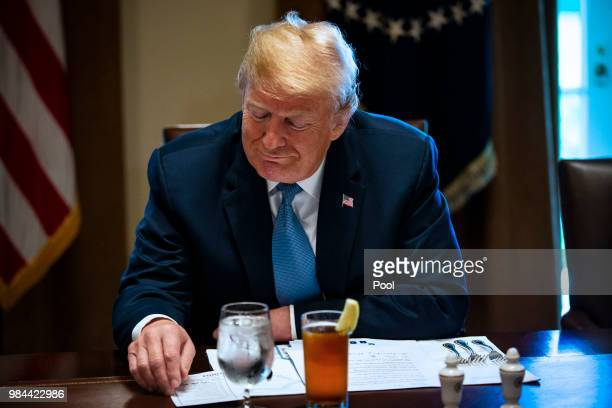 S President Donald Trump attends a lunch meeting with Republican lawmakers in the Cabinet Room at the White House June 26 2018 in Washington DC The...