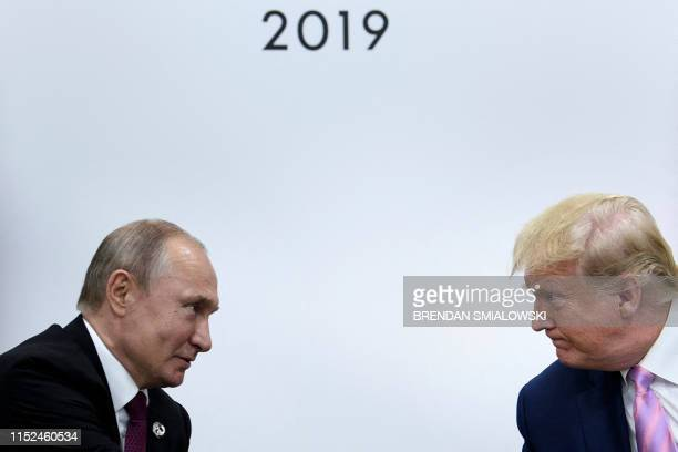 President Donald Trump attends a meeting with Russia's President Vladimir Putin during the G20 summit in Osaka on June 28 2019