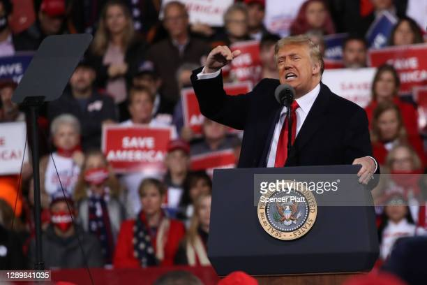 President Donald Trump attends a rally in support of Sen. David Perdue and Sen. Kelly Loeffler on December 05, 2020 in Valdosta, Georgia. The rally...