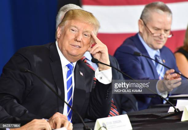 US President Donald Trump attends a round table discussion on tax reform at White Sulpher Springs Civic Center in White Sulpher SpringsWest Virginia...