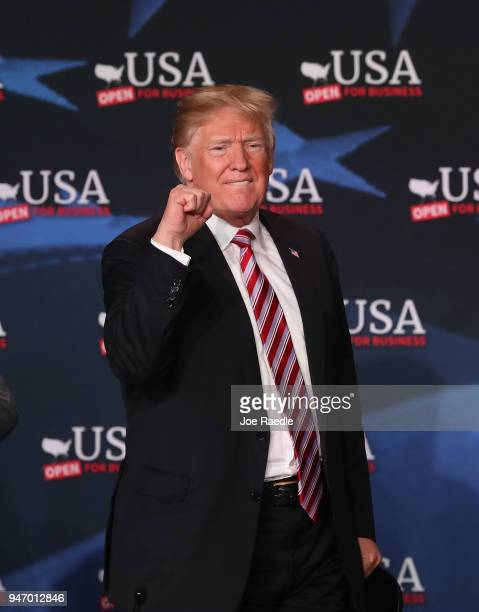 S President Donald Trump attends a roundtable discussion about the Republican $15 trillion tax cut package he recently signed into law on April 16...