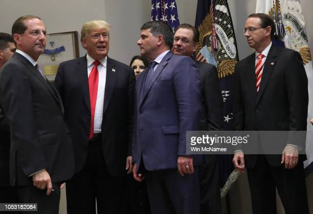 "S President Donald Trump attends a signing ceremony with Deputy Attorney General Rod Rosenstein for the 'Know the Lowest Price"" Act and the..."