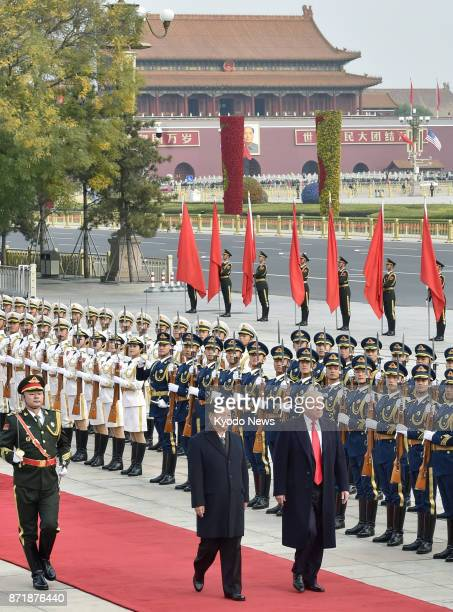 US President Donald Trump attends a welcome ceremony along with Chinese President Xi Jinping in Beijing on Nov 9 2017 ==Kyodo