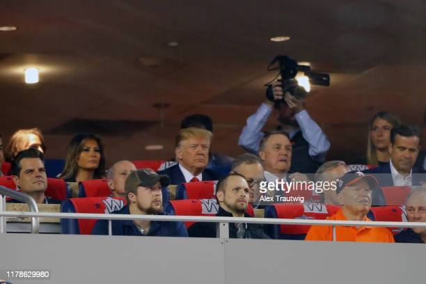 President Donald Trump attends Game 5 of the 2019 World Series between the Houston Astros and the Washington Nationals at Nationals Park on Sunday...