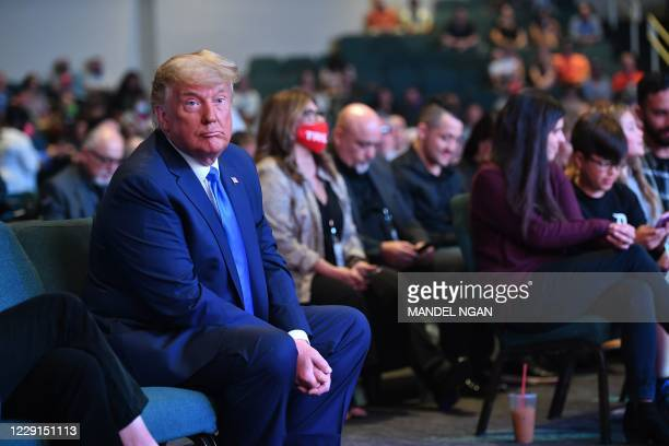 President Donald Trump attends services at the International Church of Las Vegas in Las Vegas, Nevada, where he was blessed by church members on...
