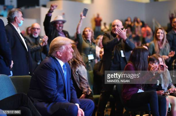 President Donald Trump attends services at the International Church of Las Vegas in Las Vegas, Nevada, where he was applauded by church members on...