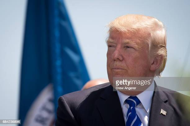 President Donald Trump attends the commencement ceremony at the US Coast Guard Academy May 17 2017 in New London Connecticut This is President...