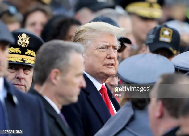 President Donald Trump attends the game between the Army Black Knights and the Navy Midshipmen at Lincoln Financial Field on December 08 2018 in...