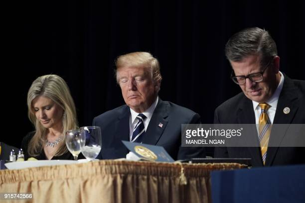 US President Donald Trump attends the National Prayer Breakfast at a hotel in Washington DC on February 8 2018 / AFP PHOTO / Mandel NGAN