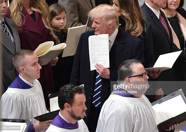 US President Donald Trump attends the National Prayer Service at the National Cathedral on January 21 2017 in Washington DC / AFP / MANDEL NGAN