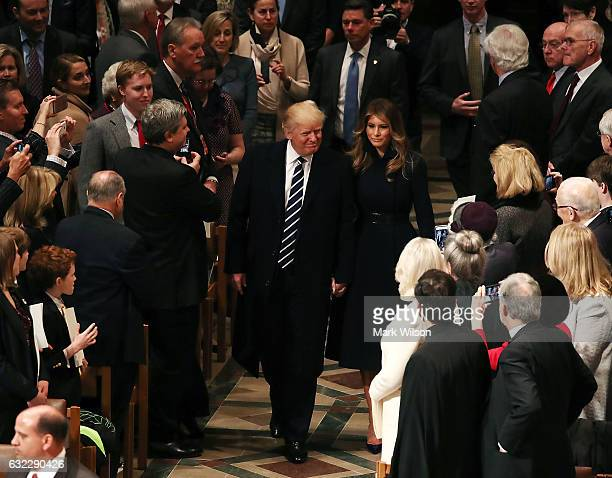 S President Donald Trump attends the National Prayer Services with his wife first lady Melania Trump at the National Cathedral on January 21 2017 in...