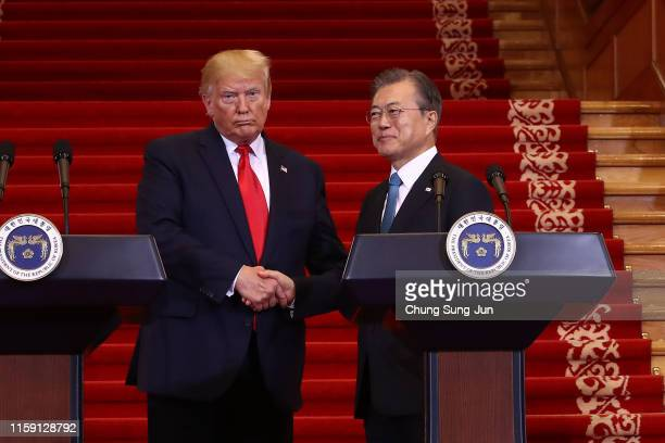 President Donald Trump attends with South Korean President Moon Jae-in during the joint press conference at the presidential Blue House on June 30,...
