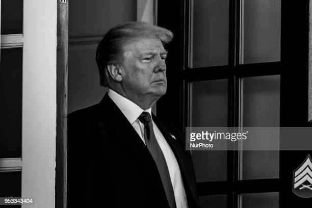 US President Donald Trump awaits the arrival of President Muhammadu Buhari of the Federal Republic of Nigeria to the West Wing Portico of the White...