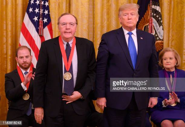 US President Donald Trump awards author James Patterson the National Humanities Medal in the East room of the White House on November 21 2019