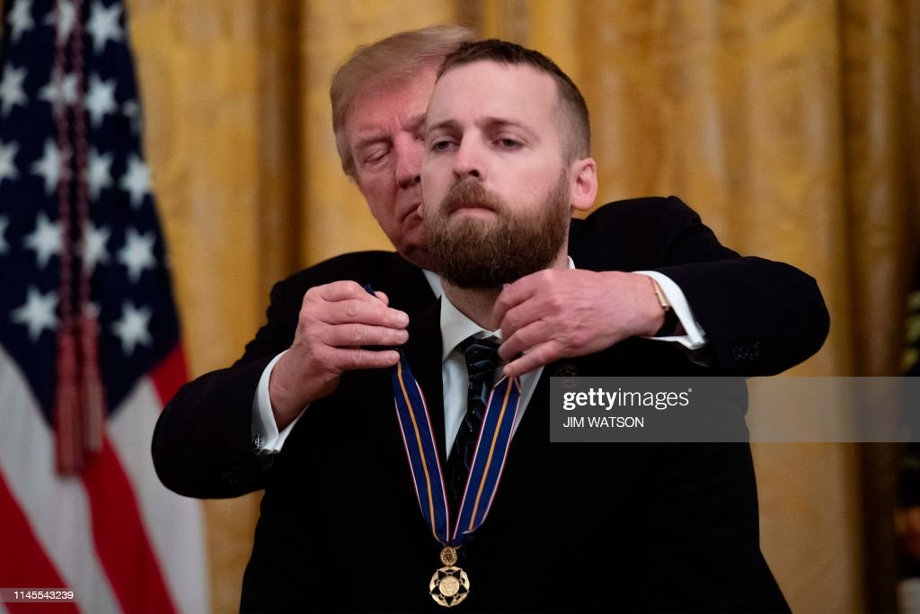 us-politics-trump-medal-valor : News Photo