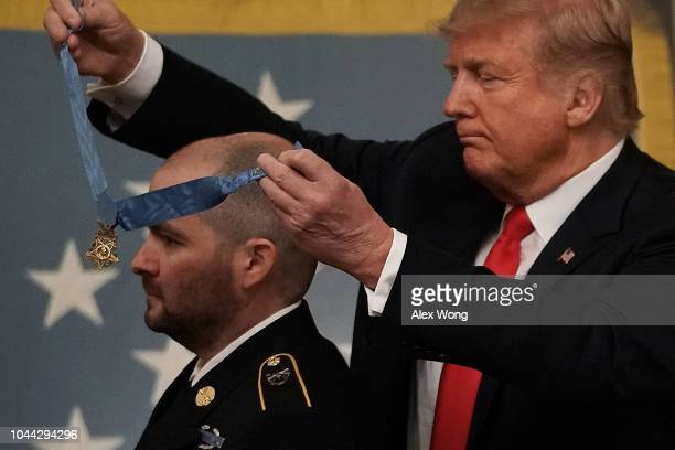 S President Donald Trump awards the Medal of Honor to Ronald J Shurer II during an East Room ceremony at the White House October 1 2018 in Washington...