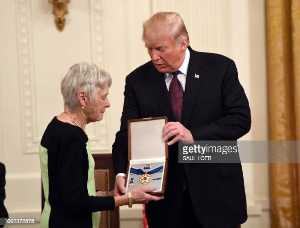 US President Donald Trump awards the Presidential Medal of Freedom to the late Supreme Court Justice Antonin Scalia his wife Maureen Scalia accepting...