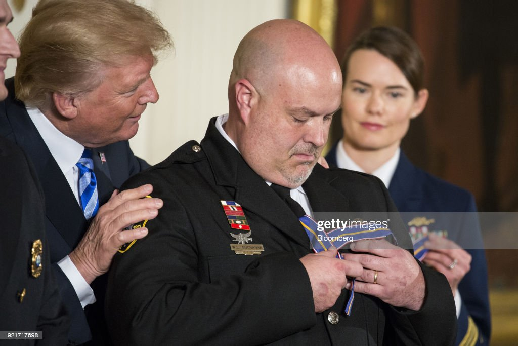 U.S. President Donald Trump awards the Public Safety Medal of Valor honor to Avery County Sheriff's Department Lieutenant William Buchanan during a ceremony in the East Room of the White House in Washington, D.C., U.S. on Tuesday, Feb. 20, 2018. The Medal of Valor is the Nation's highest award for valor by public safety officers, and serves to recognize extraordinary acts above and beyond the call of duty. Photographer: Joshua Roberts/Bloomberg via Getty Images