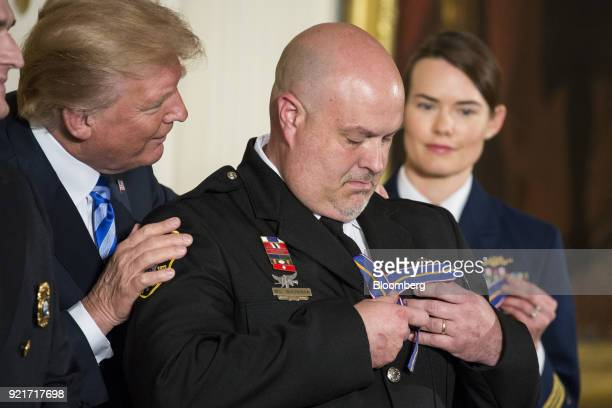 US President Donald Trump awards the Public Safety Medal of Valor honor to Avery County Sheriff's Department Lieutenant William Buchanan during a...