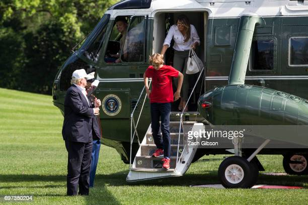 President Donald Trump Barron Trump and First Lady Melania Trump exit Marine One after arriving at The White House on June 18 2017 in Washington DC...