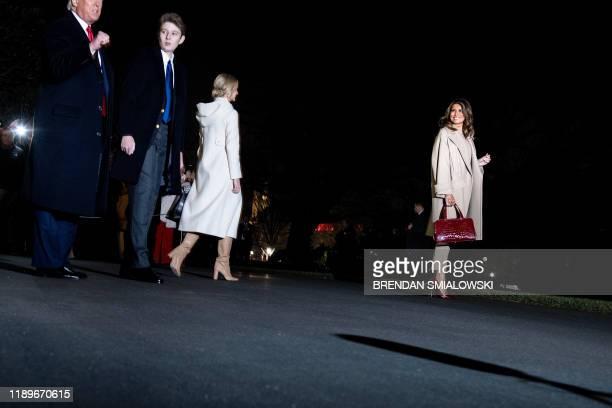 US President Donald Trump Barron Trump Senior Advisor to the President Ivanka Trump and US first lady Melania Trump walk to Marine One on the South...
