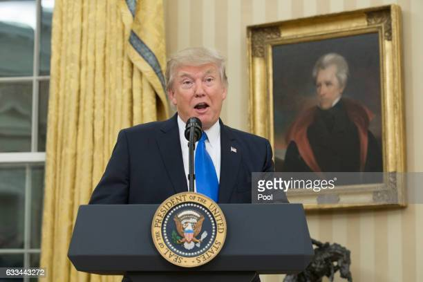 US President Donald Trump beneath a portrait of populist President Andrew Jackson speaks before the swearingin of Rex Tillerson as 69th secretary of...
