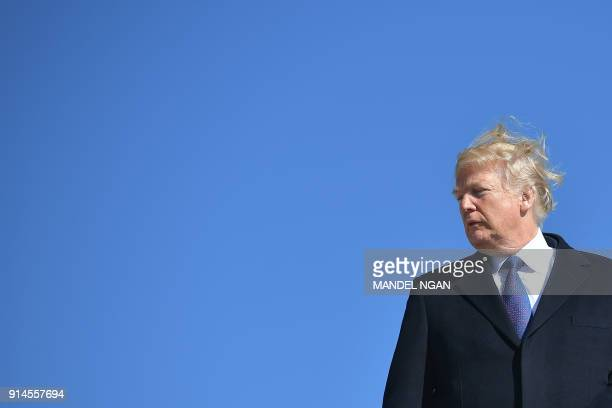 US President Donald Trump boards Air Force 1 on his way to Cincinnati Ohio at Andrews Air Force Base outside Washington DC on February 05 2018 / AFP...