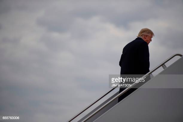 US President Donald Trump boards Air Force One at Andrews Air Force Base Maryland on March 20 2017 / AFP PHOTO / JIM WATSON