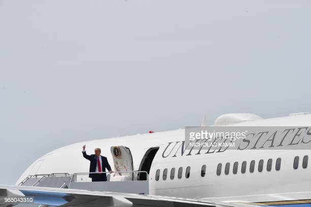 US President Donald Trump boards Air Force One at Cleveland Burke Lakefront Airport in Cleveland Ohio on May 5 2018 Trump was in Cleveland to speak...