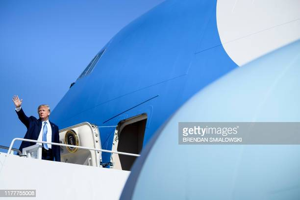 US President Donald Trump boards Air Force One at Joint Base Andrews in Maryland on October 23 as he travels to Pittsburgh Pennsylvania