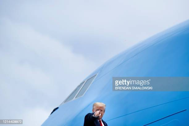 President Donald Trump boards Air Force One at Joint Base Andrews in Maryland on May 21 in Maryland Trumps travels to Michigan to tour the Ford...