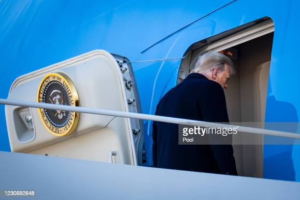 President Donald Trump boards Air Force One at Joint Base Andrews before boarding Air Force One for his last time as President on January 20, 2021 in...