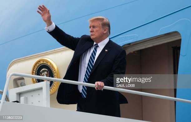 US President Donald Trump boards Air Force One at Noi Bai International Airport to leave Vietnam following the second USNorth Korea summit in Hanoi...