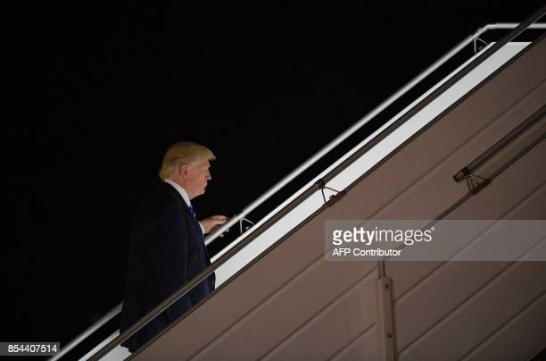 US President Donald Trump boards Air Force One before departing from John F Kennedy International Airport in New York on September 26 2017 / AFP...