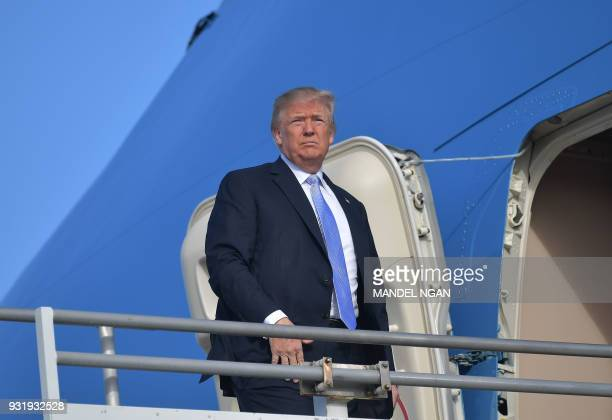 US President Donald Trump boards Air Force One before departing from Los Angeles International Airport in Los Angeles on March 14 2018 Trump is...