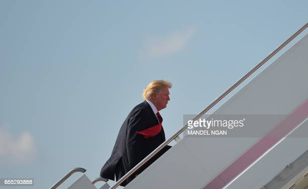 US President Donald Trump boards Air Force One before departing from Palm Beach International Airport in West Palm Beach Florida on March 19 2017...