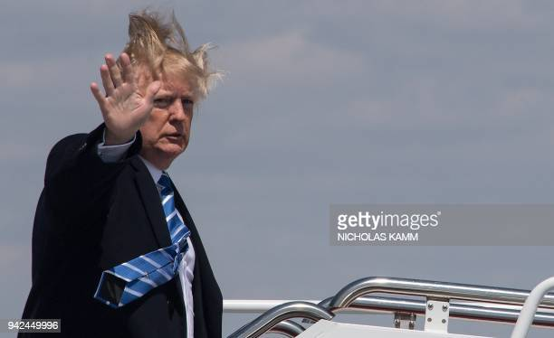 President Donald Trump boards Air Force One on a windy day at Andrews Air Force base on April 5 2018 near Washington DC Trump is heading to White...