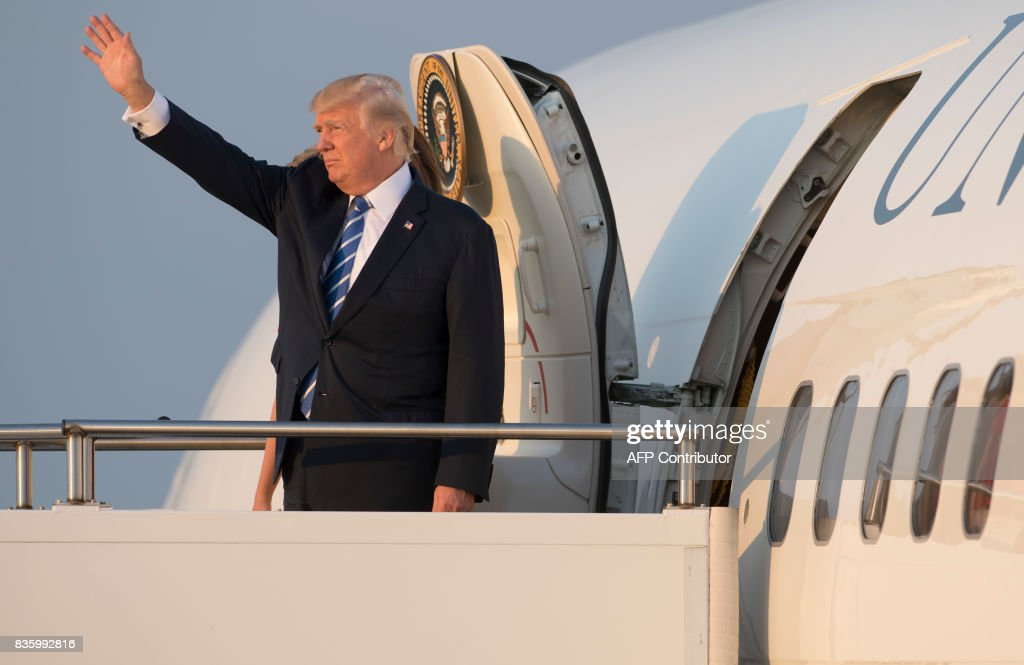 US President Donald Trump boards Air Force One prior to departing Morristown Municipal Airport in Morristown, New Jersey, August 20, 2017, as Trump returns to Washington, DC, following a 17-day vacation at his property in Bedminster, New Jersey. /