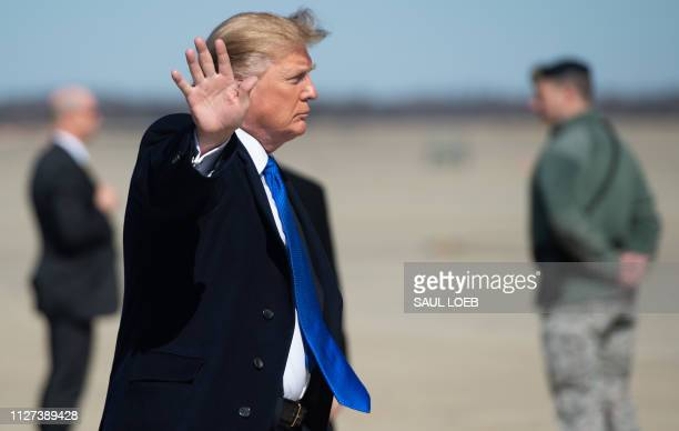 President Donald Trump boards Air Force One prior to departure from Joint Base Andrews in Maryland February 25 as he travels to Hanoi Vietnam for a...
