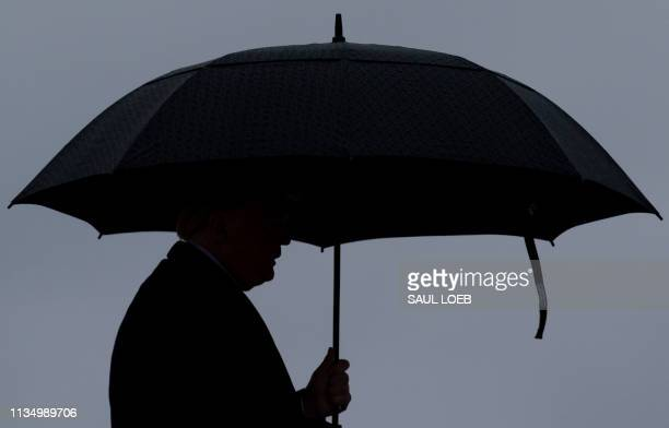 US President Donald Trump boards Air Force One prior to departure from Joint Base Andrews in Maryland April 5 2019 Trump is traveling to California...
