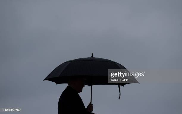 President Donald Trump boards Air Force One prior to departure from Joint Base Andrews in Maryland April 5 2019 Trump is traveling to California for...