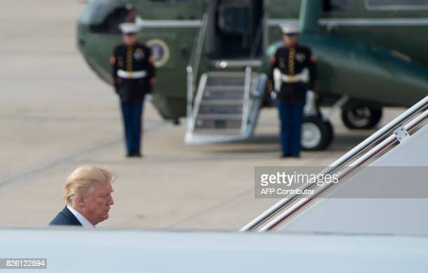 US President Donald Trump boards Air Force One prior to departure from Andrews Air Force Base in Maryland August 3 as Trump travels to a rally in...